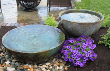 Looking for some water feature or landscape ideas for your new patio or deck in Rochester New York (NY) ?