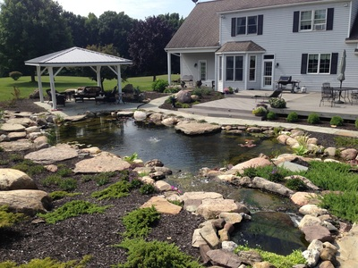 Pond repair and reneovation by Acorn Ponds & Waterfalls of Rochester NY