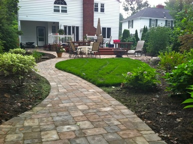 Landscape design with paver patio, walkway & water features in Rochester New York (NY) by Acorn Ponds & Waterfalls