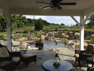 Landscape Design, Stone Patio & Pond Renovation/Installation Are Great Outdoor living Area Ideas In Rochester (NY) - Contact Acorn Ponds & Waterfalls To Get Started on Your Paradise. Image