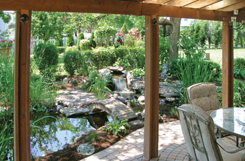 Natural Looking Water Features In Rochester NY By Certified Pond Contractors: Acorn Ponds & Waterfalls. Image