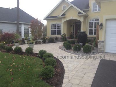 Techo-Bloc paver patio installed in Rochester New York by Acorn Ponds & Waterfalls