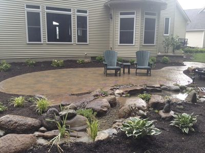 Liver shaped patio design & installation in Rochester New York (NY) by Acorn Ponds & Waterfalls.