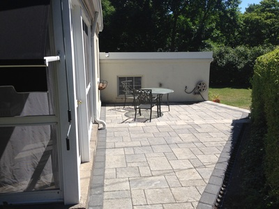 Multi tiered patio design & installation in Rochester New York (NY) by Acorn Ponds & Waterfalls