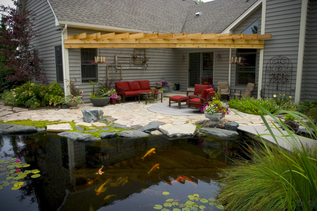 Ed Beaulieu of Aquascape Inc. Backyard Waterfall Pond. Image
