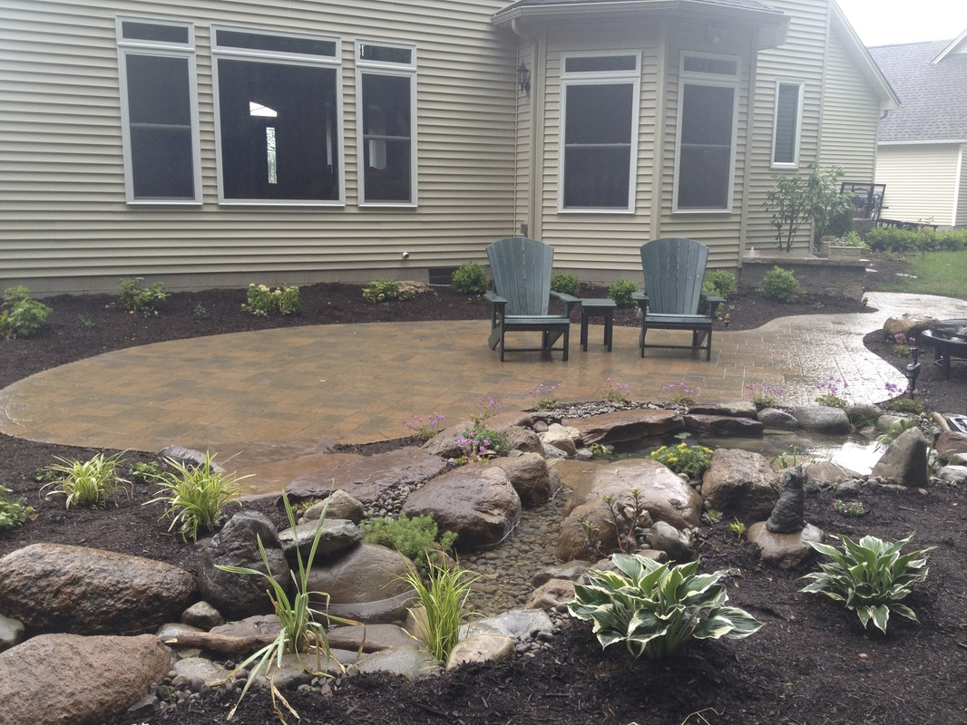 Paver patio & steps installed by Acorn Ponds & Waterfalls - Rochester New York (NY)'s premiere landscape contractors