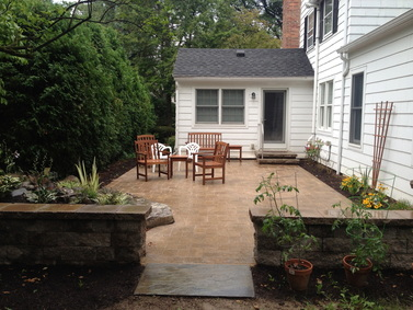 Backyard paver patio design & installation ideas in Rochester New York (NY) By Acorn Ponds & Waterfalls