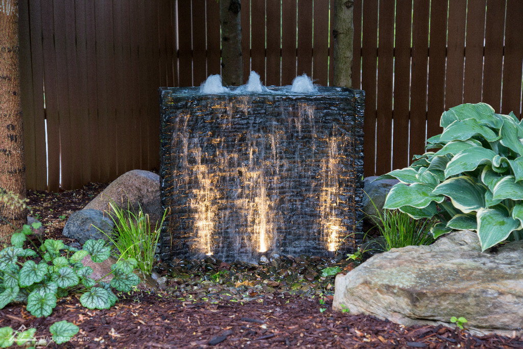 Landscape Fountain Ideas That Will Take You To A Peaceful Paradise In Rochester NY By Acorn Ponds & Waterfalls. Image