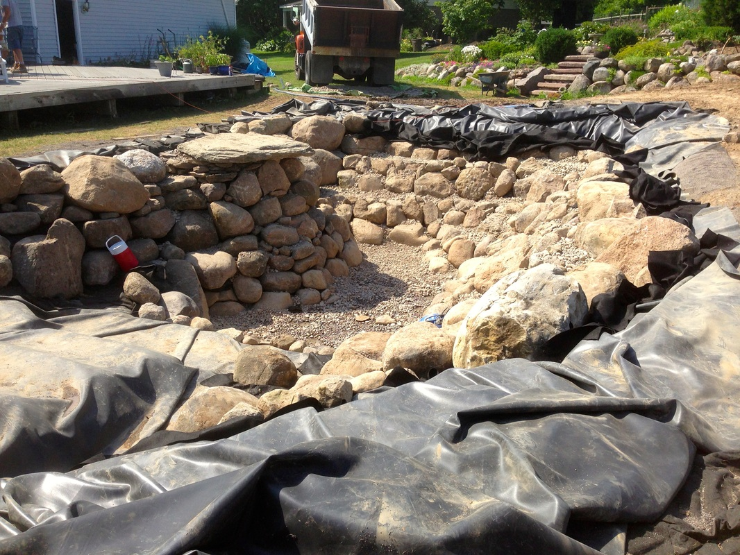 Pond Rock & Boulder Installation In Rochester NY By Acorn Ponds & Waterfalls Call 585-442-6373