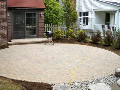 Circular shaped patio design & installation in Rochester New York (NY) by Acorn Ponds & Waterfalls.