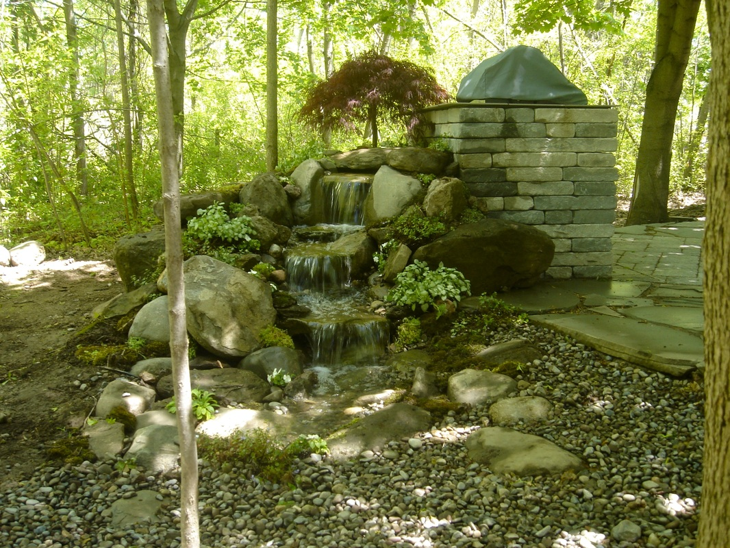 Display Pondless Waterfall Water Feature in Rochester, NY by Acorn Ponds & Waterfalls. Image