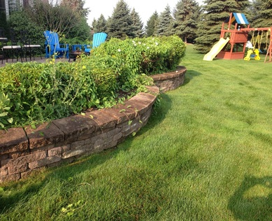 Retaining Wall Repair & Renovation In Rochester, Monroe County (NY) By Acorn Ponds & Waterfalls. Have a professional install your retaining wall and get the job done right... The First Time! Image