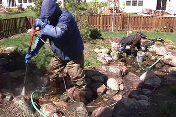 Cleaning a koi fish pond in Rochester New York (NY) is labor intensive work - Let Acorn do all the heavy lifting for you!
