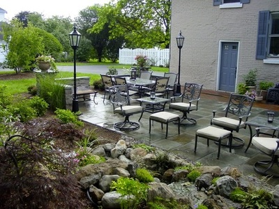 Natural cut slate, formal looking patio design & construction by Acorn Ponds & Waterfalls in NY
