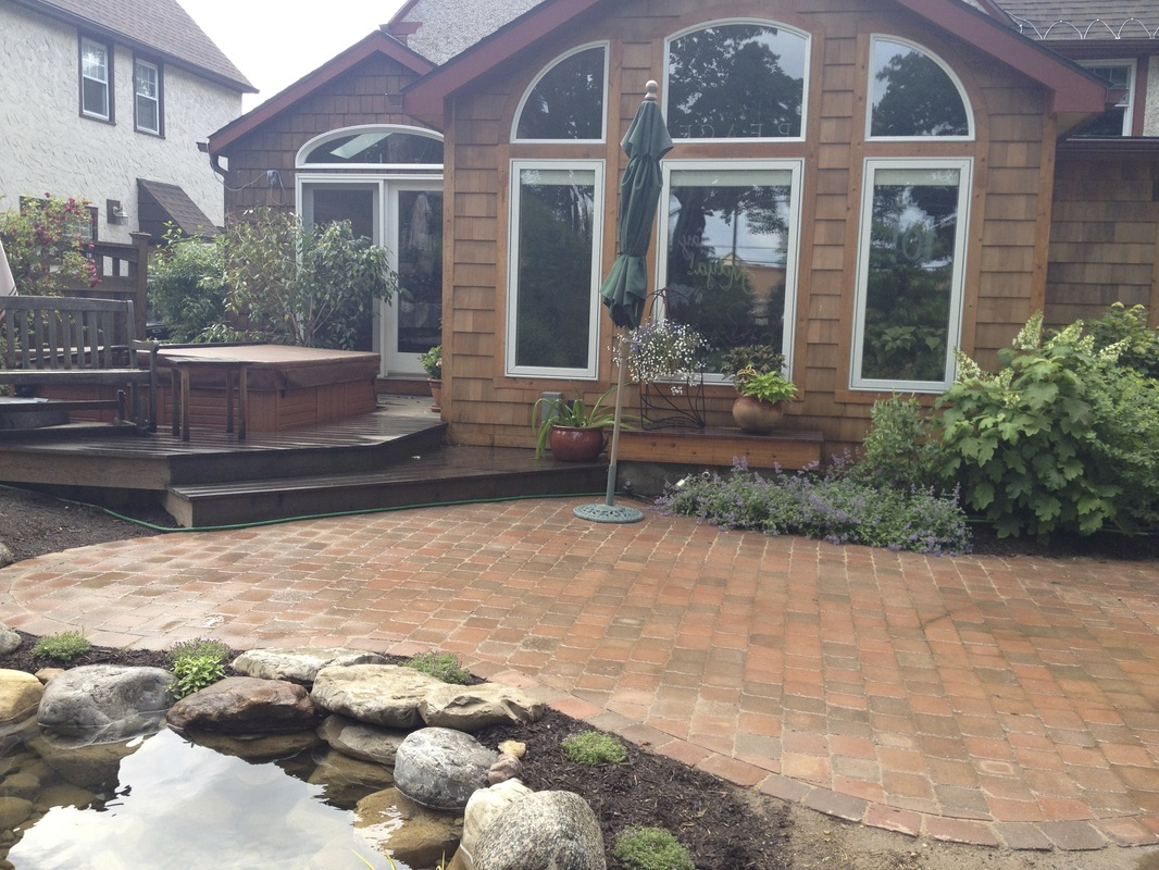 Outdoor room with hot tub & landscape design installed with fish pond, patio renovation, and plantings in Greece Monroe County NY By Acorn Of Rochester New York (NY)