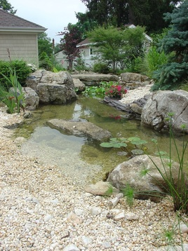 Picture: Waterfall Pond Maintenance Services in Chili & Greece, Monroe County NY By Acorn Ponds & Waterfalls