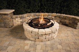 Fire-Pits are great for enhancing your water feature, patio & deck in Rochester NY by Acorn Ponds & Waterfalls.