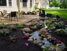 Natural looking streams are great ideas for outdoor patios, decks & koi ponds in Rochester (NY)