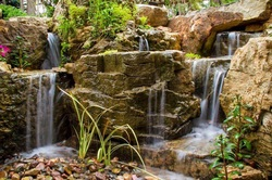 Natural Looking Waterfalls Installation Services In Rochester New York (NY) - Acorn Ponds & Waterfalls 585-442-6373