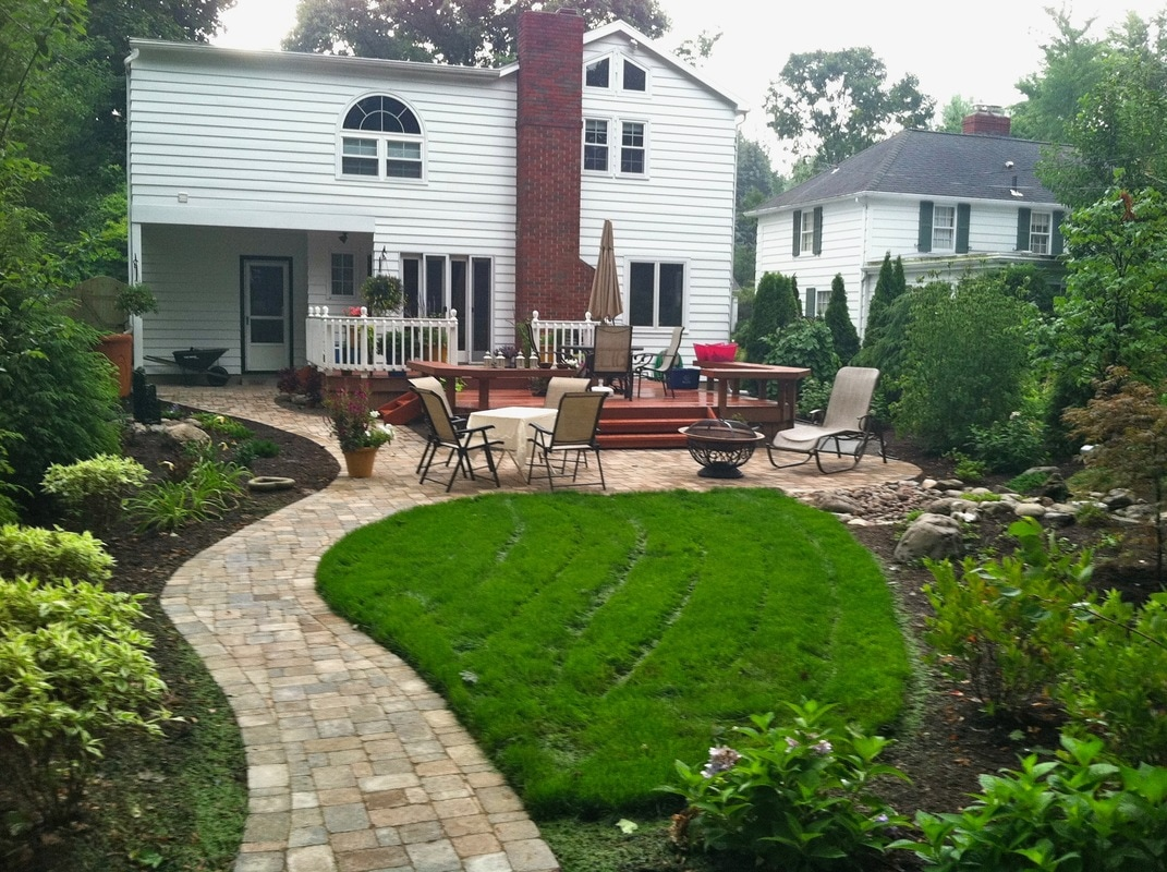 landscaping ideas in Rochester NY, Outdoor Living Area, water feature, patio renovation, landscape lighting and landscape design in Rochester, Monroe County NY By Acorn Ponds & Waterfalls. Image