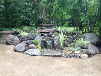 Pondless Waterfall Construction in Rochester NY By Acorn Ponds & Waterfalls
